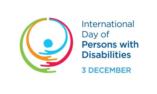 Graphic circles like arms in blue, red, orange and green embracing a blue dot TextInternational day of persons with disabilities 3 december